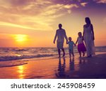 family walking beach sunset... | Shutterstock . vector #245908459