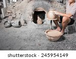 hands of potter do a clay pot... | Shutterstock . vector #245954149