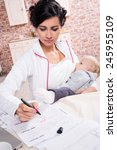young mother working while... | Shutterstock . vector #245955109
