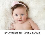 Newborn Baby Girl Posed In A...