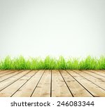 wooden planks with green grass... | Shutterstock . vector #246083344