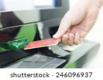 man insert credit card into atm | Shutterstock . vector #246096937