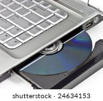 Optical disc placed in a laptop drive - stock photo