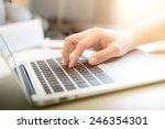 woman's hands typing on laptop... | Shutterstock . vector #246354301