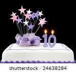 Fancy cake with number 10 candles.  Decorated with star-shapes and ribbons, in pastel tones. - stock photo