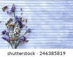 dried flowers on color wooden... | Shutterstock . vector #246385819