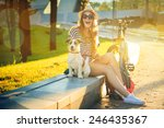 Happy hipster girl with her dog ...