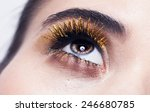 gold lashes macro shot of woman'... | Shutterstock . vector #246680785