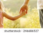 a parent holds the hand of a... | Shutterstock . vector #246686527