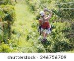 woman going on a jungle zipline ... | Shutterstock . vector #246756709