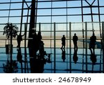 travelers silhouettes at airport | Shutterstock . vector #24678949