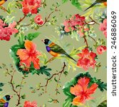 Seamless pattern with wild exotic birds on the branch with flowers on green background vector illustration