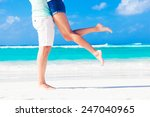 legs of young kissing couple on ... | Shutterstock . vector #247040965