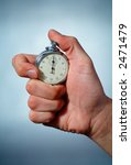 photo of a hand with a stopwatch | Shutterstock . vector #2471479