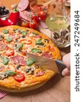 delicious pizza served on... | Shutterstock . vector #247249684