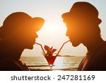 Stock photo party time couple drinking cocktail together on the beach during their honeymoon 247281169