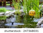 small fountain in the pond | Shutterstock . vector #247368031