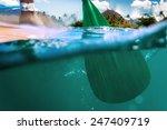 oar of paddle boarder half way... | Shutterstock . vector #247409719