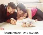 Happy Young Parents With Their...