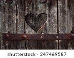 Heart Carved In Wood. Dark...
