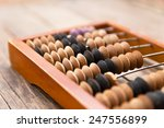 old wooden abacus on wood... | Shutterstock . vector #247556899