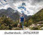 mountain traveler looks on wild ... | Shutterstock . vector #247624939