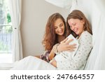 sister visiting a young mother... | Shutterstock . vector #247664557