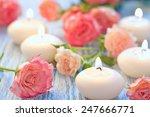 pink roses bouquet on a wooden... | Shutterstock . vector #247666771