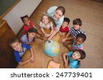 cute pupils smiling around a...   Shutterstock . vector #247739401
