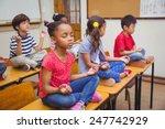 pupils meditating in lotus...