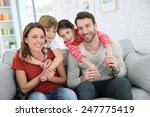 cheerful family at home sitting ... | Shutterstock . vector #247775419