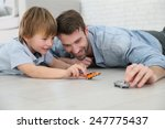 daddy with little boy playing... | Shutterstock . vector #247775437