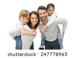 young parents giving piggyback... | Shutterstock . vector #247778965