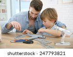 father and son assembling... | Shutterstock . vector #247793821