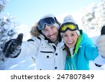 Cheerful Couple Of Skiers...