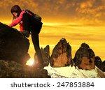 girl on rock  in the background ... | Shutterstock . vector #247853884