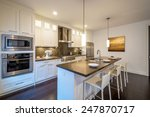 Stock photo modern bright clean kitchen interior with stainless steel appliances in a luxury house 247870717