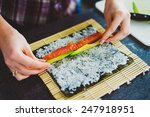girl is making sushi at home | Shutterstock . vector #247918951