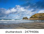 Atlantic clouds over Portreath pier and the Pepperpot, Cornwall UK - stock photo