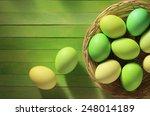 Easter Eggs Basket On Wooden...