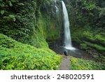 hiker standing in front of huge ... | Shutterstock . vector #248020591