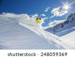 skier skiing downhill in high... | Shutterstock . vector #248059369