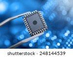 Computer Chip With Tweezers ...