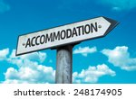 Small photo of Accommodation sign with sky background