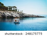 boat with people on the sea by... | Shutterstock . vector #248175775