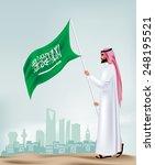 saudi arabia man holding flag... | Shutterstock .eps vector #248195521