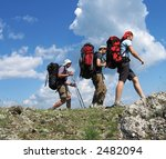 Three climbers going about stone - stock photo