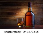 Bottle Of Whiskey On A Wooden...