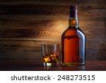 bottle of whiskey on a wooden... | Shutterstock . vector #248273515