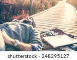 urban man lying on a catwalk in ... | Shutterstock . vector #248295127